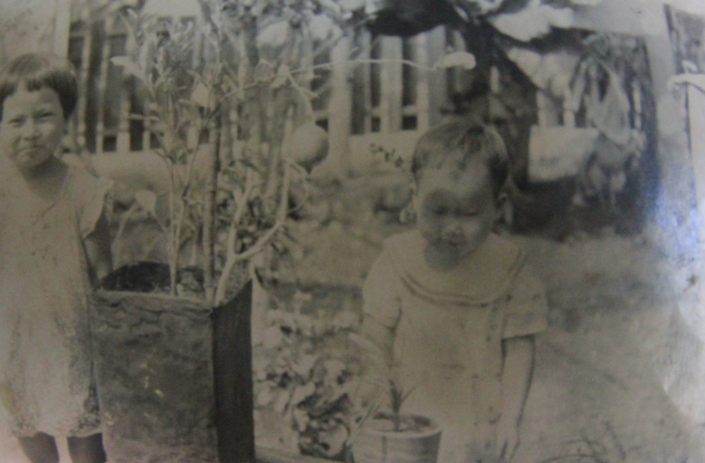 Saito Imako and her sibling at their Garapan residence on Saipan before WWII